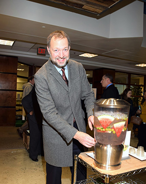 A guest serves himself fruit-infused water from one of the hydration stations.