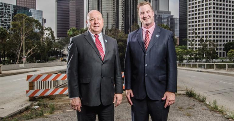 Dennis Barrett retiring LAUSD director of foodservices left and David Binkle interim director outside the districts downtown office headquarters