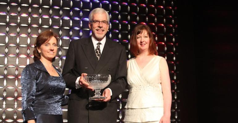 Russ Meyer accepts the 2012 NACUS Theodore Minah Award from 2012 NACUFS president Nona Golledge l and past president Janet Paul Rice