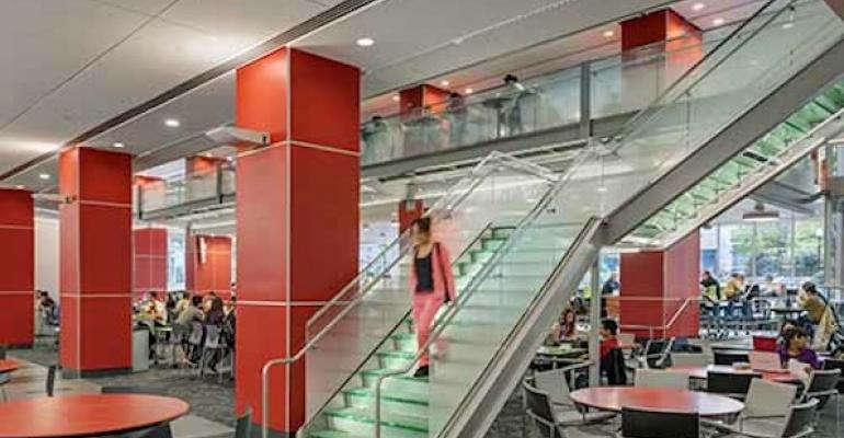 A glass stair connects the lower dining area with a new 3000 sqft suspended glass mezzanine with 168 dining seats and 28 lounge seats in Northeastern Universitys new Curry Student Center
