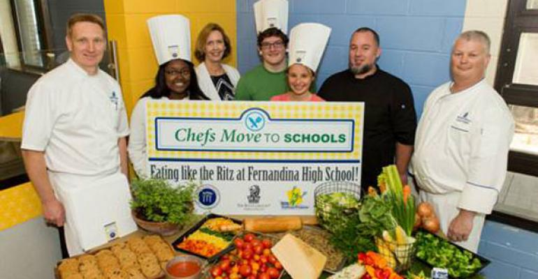 PUTTIN ON THE RITZ Left to right Thomas Tolxdorf executive chef of The Ritz Carlton Amelia Island Amari Forrest Fernandina Beach High School FBHS studentAllyn Graves director of school food service of  Nassau County School BoardBishop Richards FBHS student Laura Perkins FBHS student Michael Gasschef and culinary teacher at FBHS and Glenn Wright chef at The Ritz CarltonAmelia Island