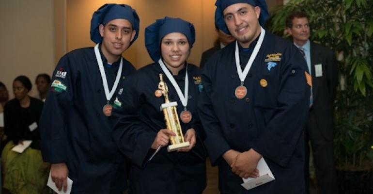 The winning team from Santa Ana CA High School in the Cooking Up Change cooking contest l to r Carlos Ortiz Cecilia Magana and Cesar Amezcua