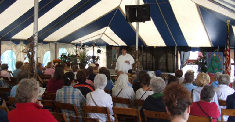 Chef Kevin Burke of Ashland University gets fairgoers excited for the flavors of fall with a demo of Double Cranberry Crostini and other autumn appetizers
