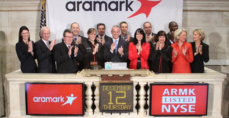 Aramark President and CEO Eric Foss joined by frontline employees and members of the management team rings the NYSE Opening Bell to celebrate the company39s IPO and first day of trading on the New York Stock Exchange