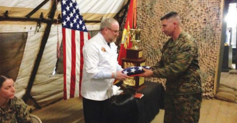 Silverstein is presented an American flag that flew over the field mess at Camp Pendleton CA