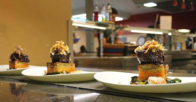 Colorado filet mignon with rich demiglaze pan seared scallops with a classic beurre blanc accompanied by sauteacuteed rainbow Swiss chard and dauphinois potato was served as part of the Sept 25 Secret Supper at Colorado State