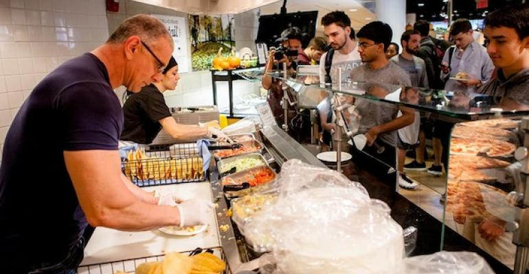 Food Network star Robert Irvine helps prepare a dish for students at Columbia University during a recent appearance