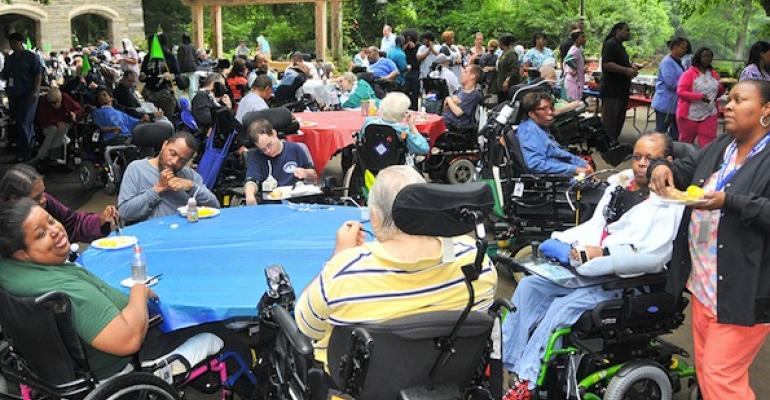 Residents of Inglis House enjoy a picnic lunch one way the dining department tries to encourage communal activity and provide monotony breakers for the facility39s wheelchairbound patients