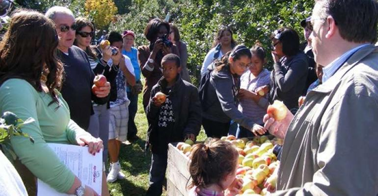 Students learn about where food comes from during a farm tour hosted by Thompson