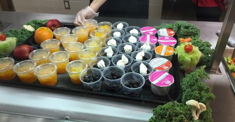 Fruit cups displayed on a Mansfield elementary school cafeteria serving line