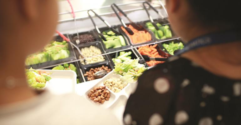 Students selecting items from a salad bar In addition to providing financial support to serve healthier items the foundation also provides training for school nutrition staff