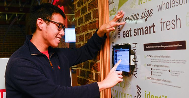 A student checks out the allergen info for the dayrsquos menu at one of the interactive iPads installed for the purpose at NC State dining venues