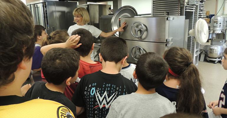 Shelley Mello hosts a group of students on a behindsthescenes tour of the schoolrsquos kitchen