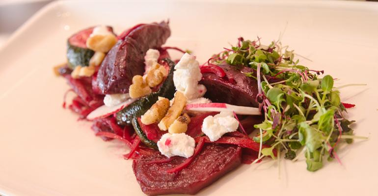 Roasted Beet Salad with radish, goat cheese crumble, spiced walnuts and birch syrup vinaigrette