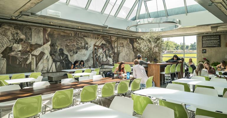 An abundance of natural light increased transparency and custom LED lighting improves the overall ambiance and allows for flexible seating quiet study and lounge spaces and a more engaging connection to the outdoors