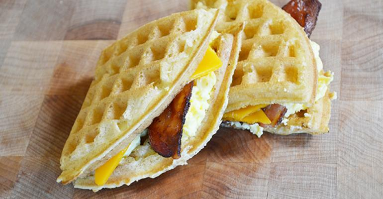 Griddle Me This features a freshbaked waffle toped with eggs cheddar cheese and in this pictured version applewood bacon
