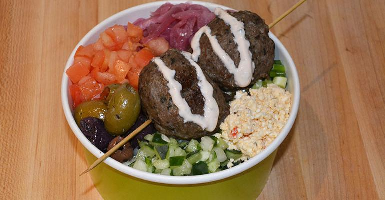 Customers can build their own bowls by selecting a base grains greens or a pita add a ldquoflavor explosionrdquo preserved lemon hummus burnt eggplant hadari or spicy feta a skewer falafel chicken or meatballs toppings including pickled red onion roasted cauliflower and marinated olives and a sauce including harissa vinaigrette and tahini