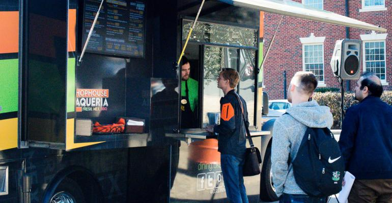 Students line up to try the MexicanBBQ fusion stylings of Oklahoma State39s new Taqueria food truck at its grand opening Jan 15