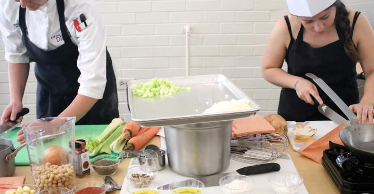 Participants at a Food Forward event at Northwestern University learn how to cook with vegetables