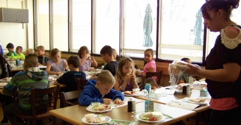 Children in an afterschool program eat meals at Socorro General Hospital