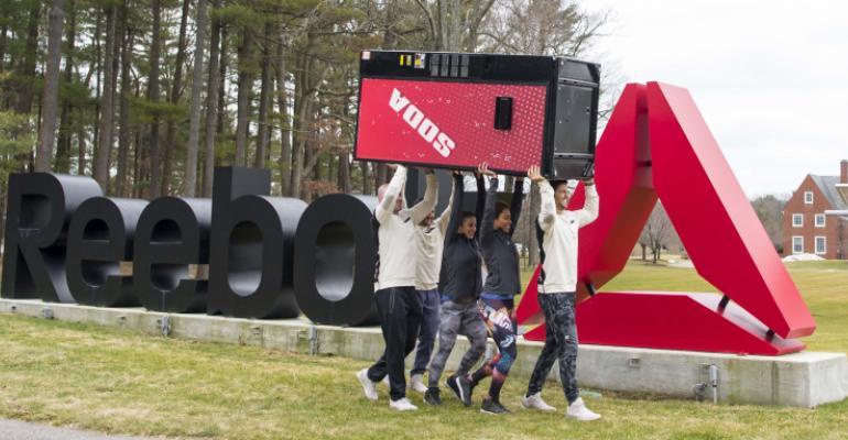 Reebok Crossfit box members remove a soda vending machine