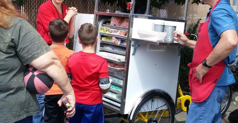 Tricycle cart offers economical summer feeding solution for district