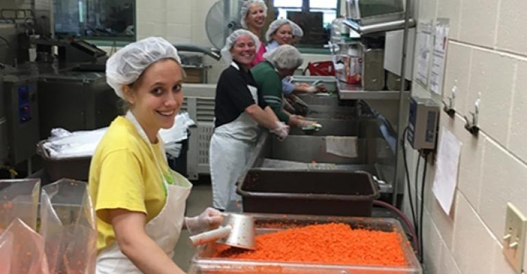 Diced carrots being portioned into vacuumsealed bags for storage