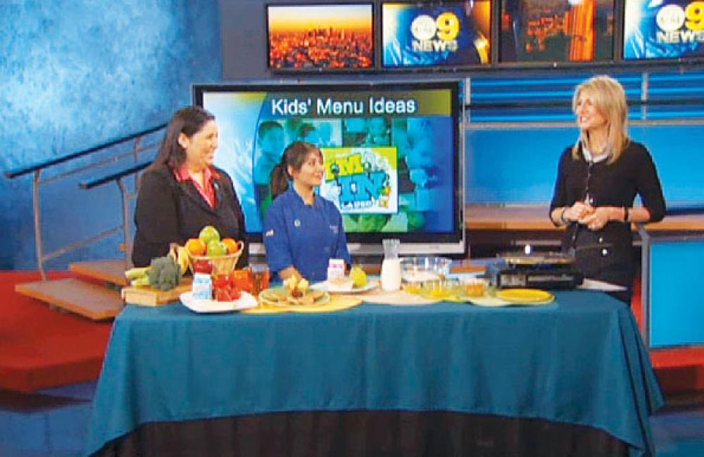 Deputy Director of Food Services Laura Benavidez  and a Francis Polytechnic high school student appeared on KCAL9 TV to describe the new dining app used at LAUSD
