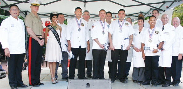 The Coast Guard Commander's team receives their medals at the conclusion of the Military Hospitality Alliance 10th Annual Military Culinary Competition.